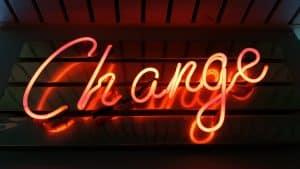 "Orange fluorescent light in cursive that says ""Change"""